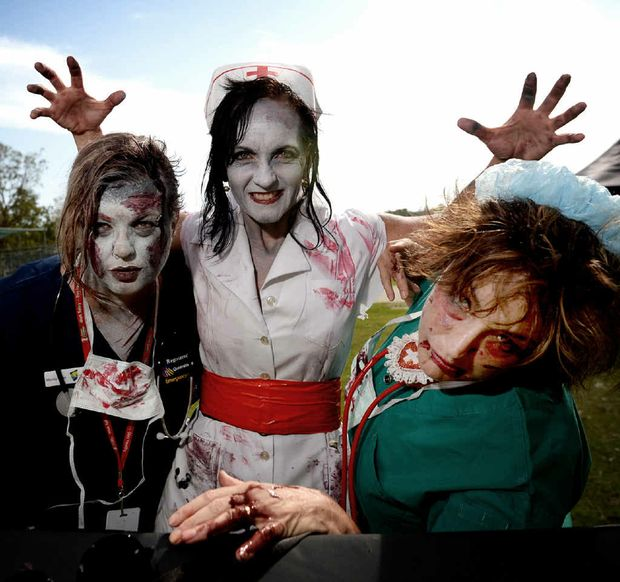RIGHT: Meridy Scott, Deb Friel and Trudy Dwyer ready for the Great Zombie Run.
