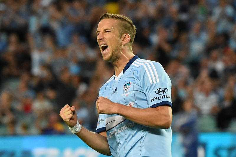 Marc Janko of Sydney FC celebrates scoring a penalty during the Round 17 A-League match against Melbourne Victory at Allianz Stadium in Sydney, Saturday, Feb. 14, 2015.