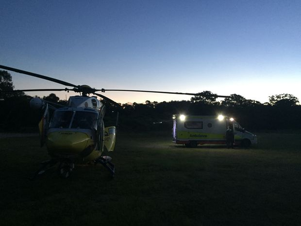 RACQ CareFlight Rescue picks up a boy on Sunday afternoon after a trail bike accident at Agnes Waters