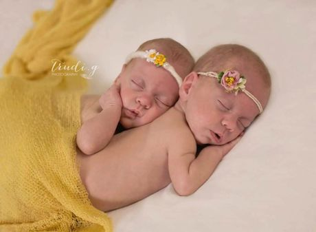 Virginia Schultz and Troy Bebendorf welcomed twins Chloe and Emily Bebendorf on December 17, 2014. They were born 12 weeks early, weighing 2lb 13oz and 3lb. They came home after eight weeks in hospital, and now, at 12 weeks, weigh 6lb each. They're sisters to Dakota and Sarah.