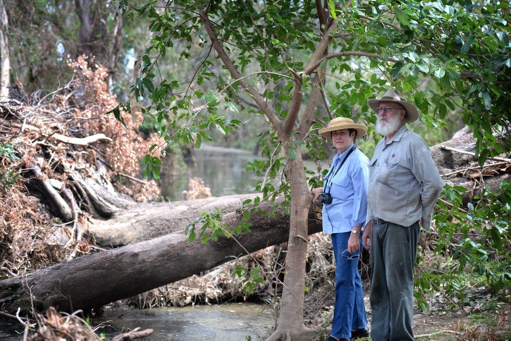 Councillor Glenda Mather and Nerimbera resident Allan Vaughan survey the damage at Black Creek, near the latter's property. Photo Allan Reinikka / The Morning Bulletin
