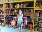 Julia Bills in her shed full of colourful bags.