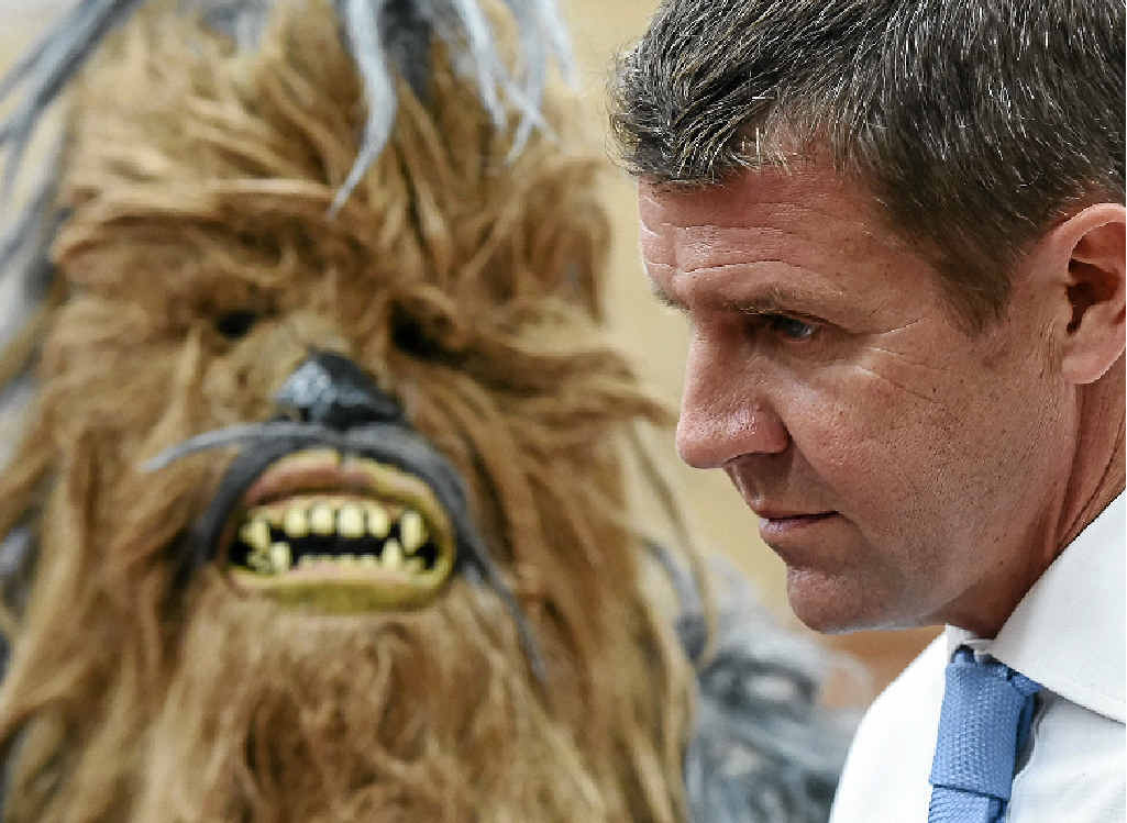 CHEW-ING THE FAT: The Queanbeyan Yowies' mascot has Premier Mike Baird's ear.