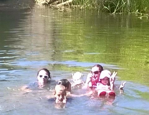 The adults in this photo claim only three children were in the water. There is debate over the mysterious fourth child, located at the back of the group.