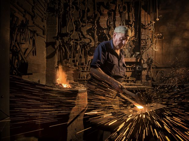SPARKS FLY: Eoin McSwan at his blacksmith workshop in South Grafton.