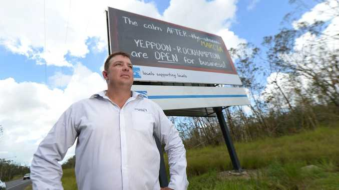 Paradise Outdoor Advertising CEO Terry McKenzie with a billboard provided by Paradise pronouncing Yeppoon and Rockhampton are open for business. Photo: Chris Ison / The Morning Bulletin