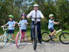 Mayor Mark Jamieson promotes Ride to School Day with the children from Coolum State School. Coolum students Lani Hutcheson, Amelia Williams and Taj Barraclough take a ride with the mayor. Photo: Warren Lynam / Sunshine Coast Daily