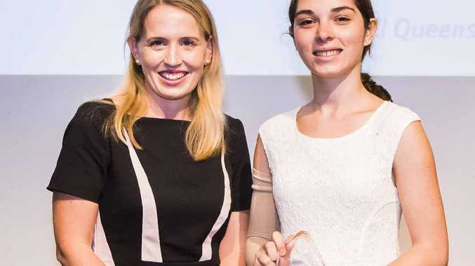 CLEVER KID: Queensland Education Minister Kate Jones with Rockhampton's Emily Pryor, the only Central Queensland student to win an inaugural Distinguished Academic Achiever award.