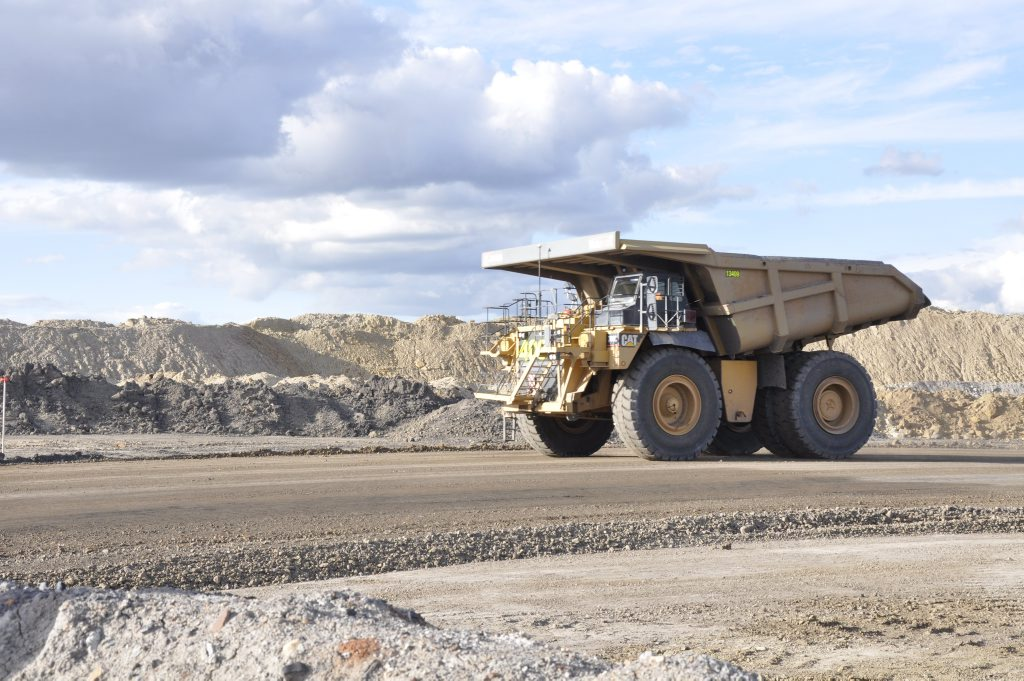 A dump truck heads out of a pit at New Acland coal mine. Photo: Stuart Cumming / The Chronicle
