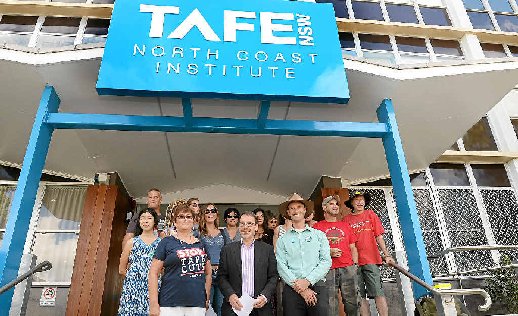 Greens NSW MP John Kaye (in jacket) with Lismore candidate Adam Guise (in hat) at Lismore TAFE yesterday with students and teachers union organiser Kathy Nicholson (front left) to talk about the Greens' plan Fund TAFE First.