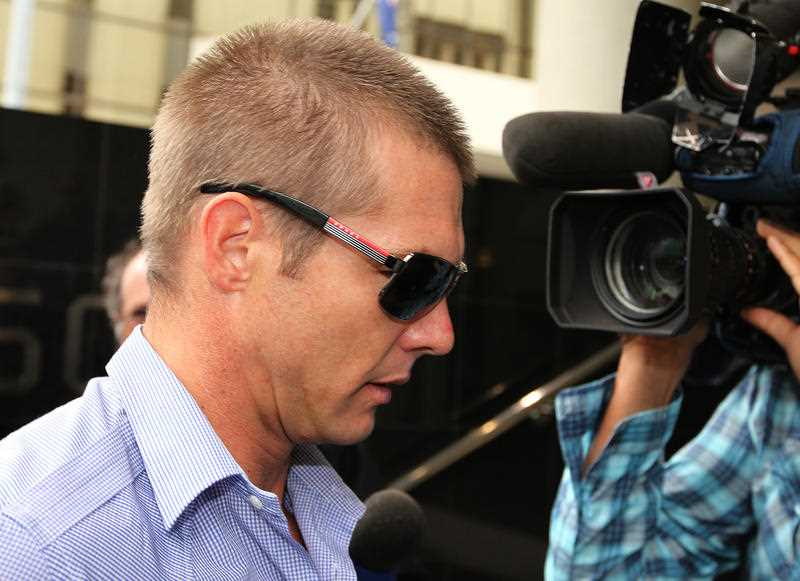 Former AFL footballer Ben Cousins arrives at the Perth Magistrate's Court to face charges of possession with intent to sell or supply methamphetamine, Perth, Monday, April 2, 2012. Police allege Cousins had drugs hidden inside his body when he was arrested at Esperance Airport last Tuesday.