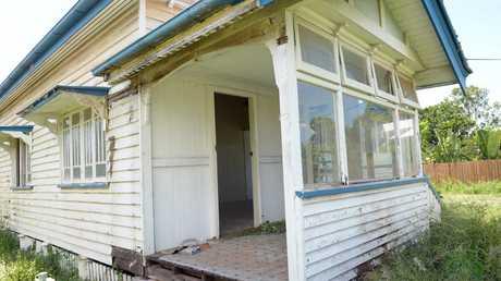 MISSING DOOR: The original ornate door was stolen from this old Bundaberg home. Photo: Max Fleet / NewsMail