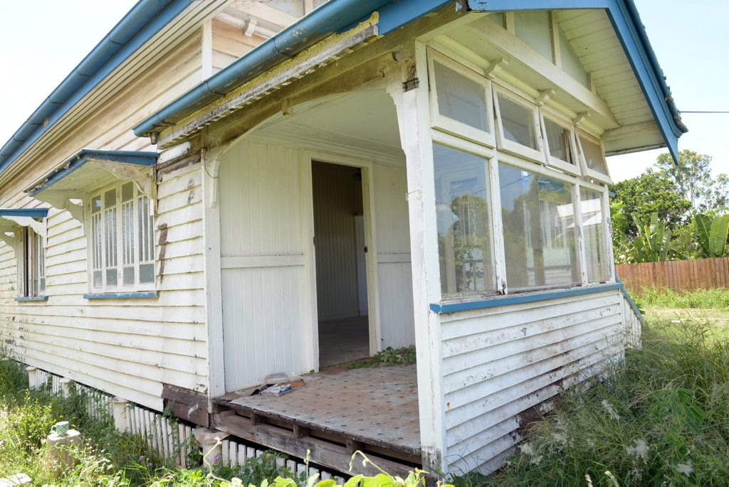 MISSING DOOR: The original ornate door was stolen from this old Bundaberg home. Photo: Max Fleet / NewsMail