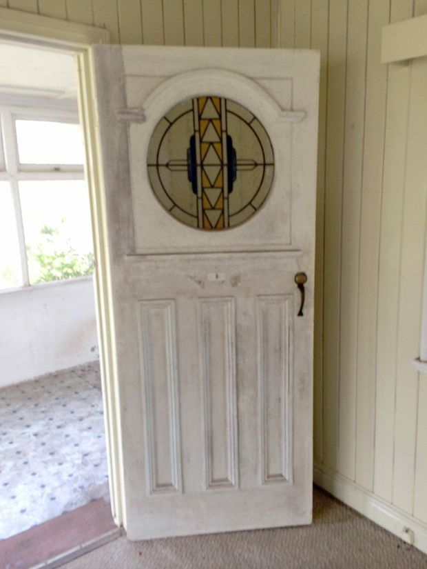 MISSING DOOR: This original ornate door was stolen from this old Bundaberg home. Photo: Contributed