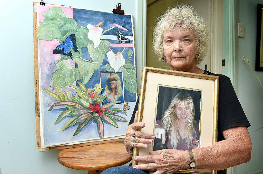 Ligita Sternberg with a portrait and a painting of her daughter Ingrid Lester.
