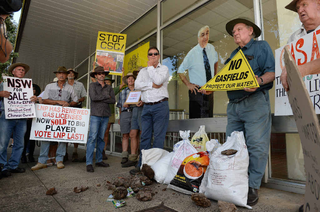 NOT HAPPY: Northern Rivers' farmers paid a visit to Thomas George's Lismore office in Carrington St with bags of cow manure to show what they think of the Coalition's gas policies.