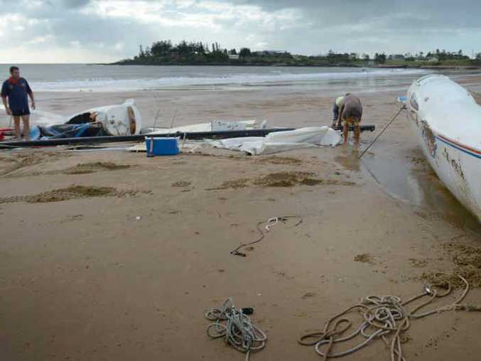 BROKEN SAILS: Abe Sweaney is hoping to see better days after his dad's catamaran was smashed to pieces and washed up at Tanby Point on Wednesday.