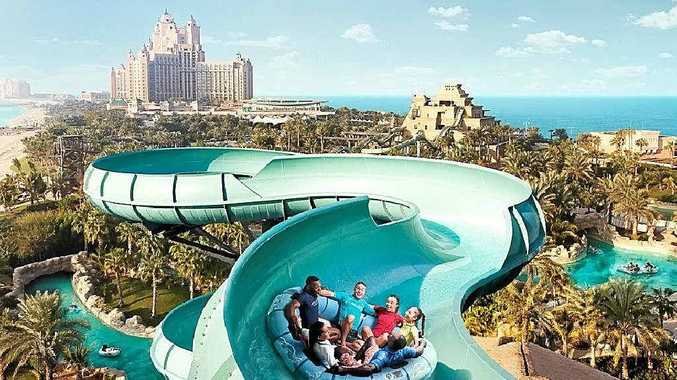 Take a fast and wet ride down a twisting chute sitting in a big tube into a lagoon full of sharks.