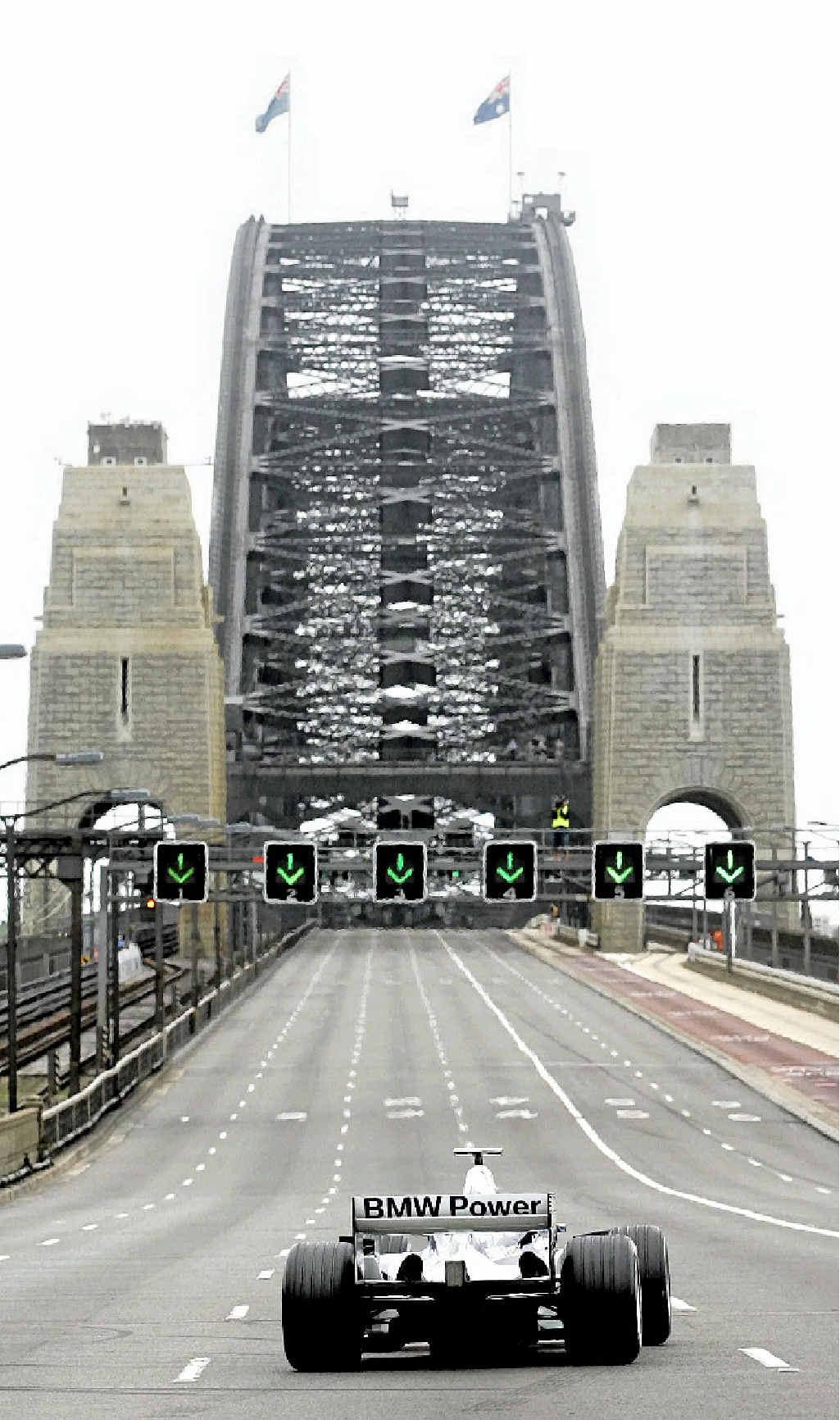 BRIDGE TOO FAR: Former Australian Formula One driver Mark Webber on a promotional run over the Sydney Harbour Bridge in 2005.