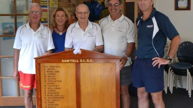 TAS teacher Jim Pennington (right) presents the special gift to Dennis Meagher, Leanne James, Bill Singleton and Steve Kelly.