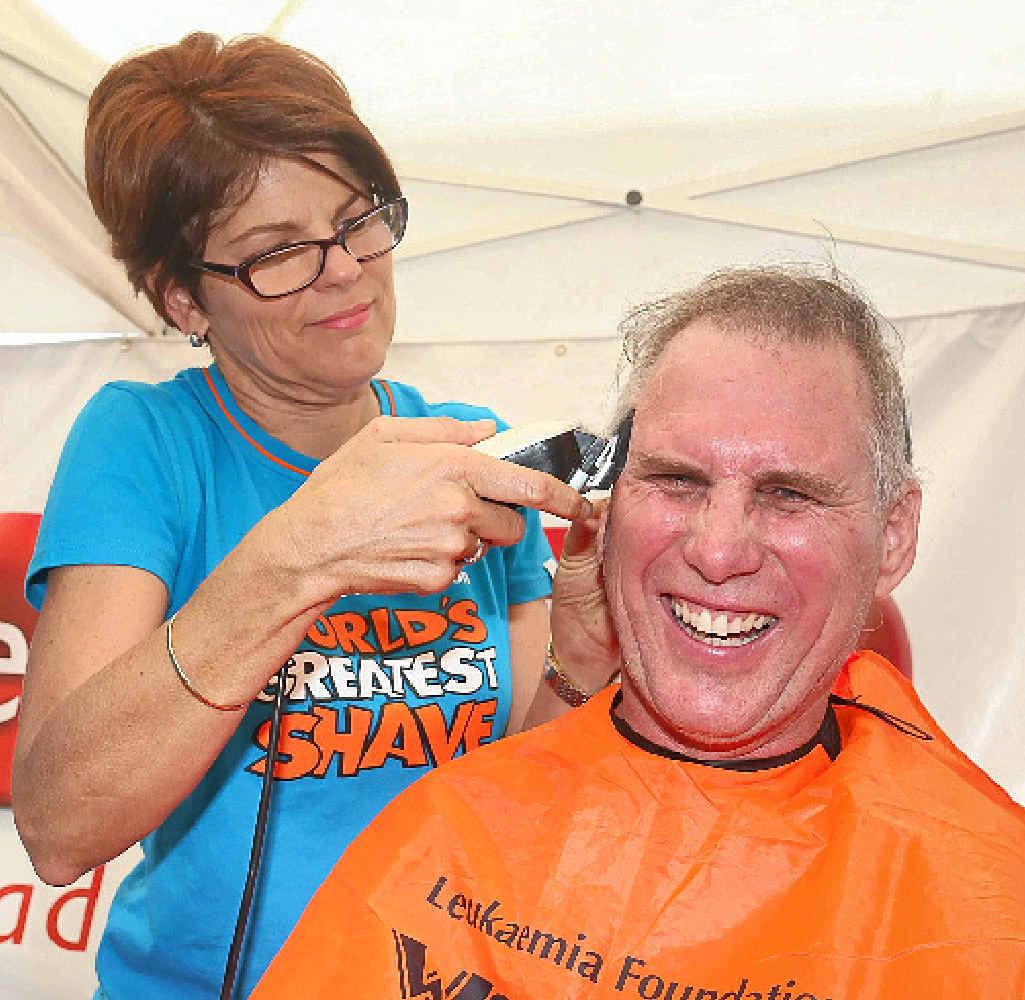 Peter Merritt gets his head shaved.