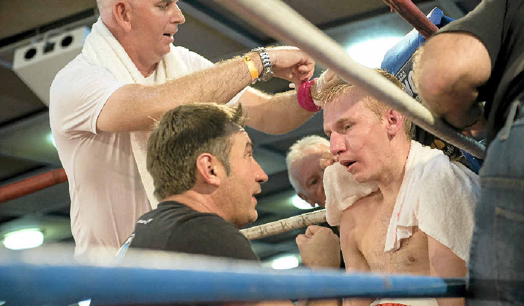 Braydon Smith receives instructions from his father and trainer Brendon Smith during his bout with John Moralde at Rumours International on Saturday night.