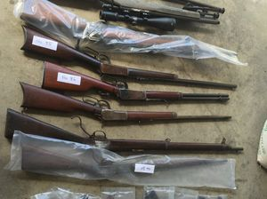 Man charged after weapons found