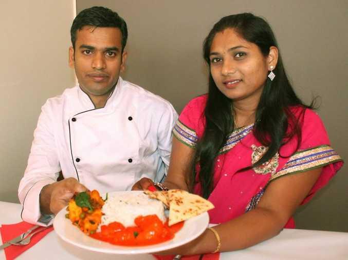 Indian Tonight chef Jothiraj Gurusamy and wife Devi Jothiraj serve up a tasty treat for their customers. Photo Austin King / The Morning Bulletin