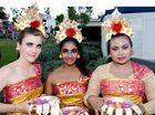 Jane Ahlstrand, Arathy Thirukumar, and Trie Mahendri in traditional costume.
