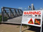 A sign has been placed at Yeppoon's main beach to warn swimmers of a croc sighting in the area. Photo Amy Haydock / The Morning Bulletin