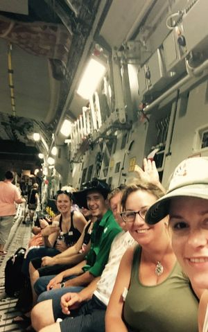 Scott and Emma fly out of Vanuatu in a C-17 plane.