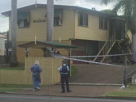 Police at the scene of a possible suspicious death inside a block of units in Maryborough's Lennox St.