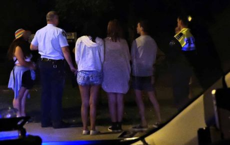 DUTY OF CARE: Police speak with underage teenagers.
