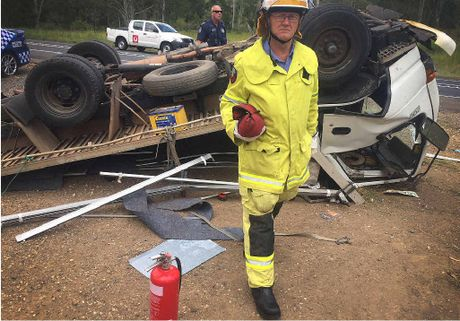 ROLLED: Gympie Fire and Rescue officer Doug Westlake walks from the scene of yesterday's crash.