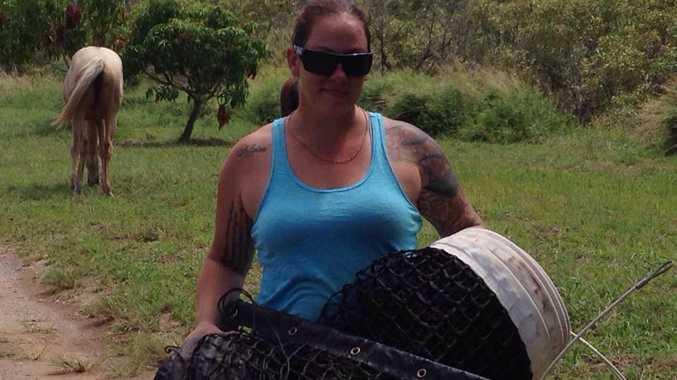 Renee Earles from Boyne Island business Axen Rugs with the tennis net she helped repair.