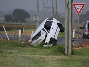 Vehicle 'nose-dives' into ditch, two injured