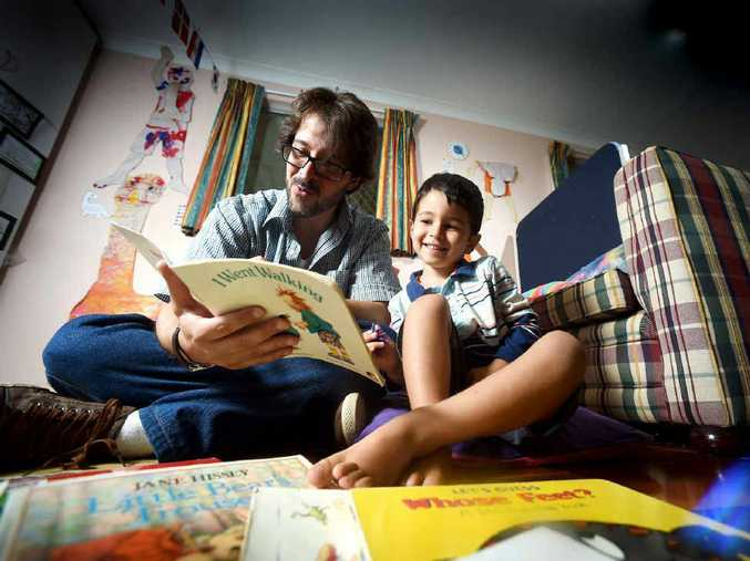 BILINGUAL FAN: Alex Spengler, of Goonellabah, with his three-year-old son Arthur encourages his boy to speak and read Portuguese wherever and whenever possible.