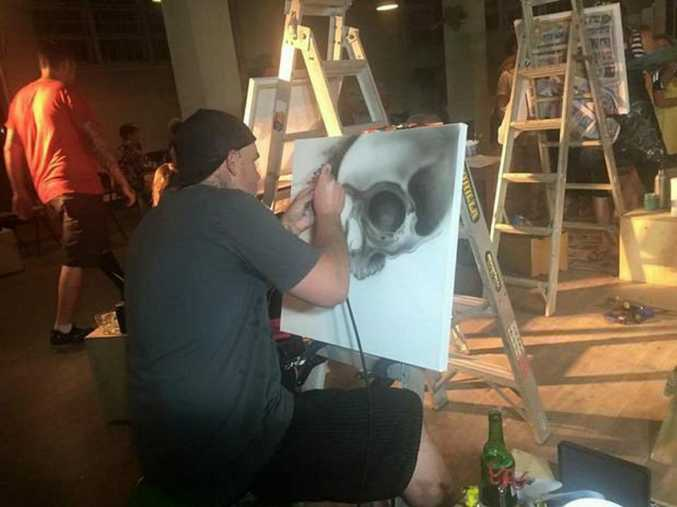 Tattoo artist, XXX tries his hand at canvas for the first at The Workshop's first art battle Photo Christine McKee / The Morning Bulletin