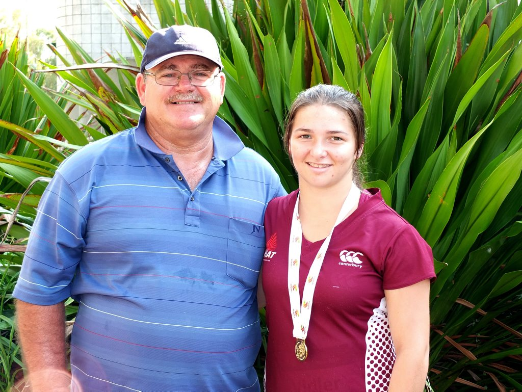 Medal-winning Ipswich and District Athletic Club competitor Rochelle Vidler and coach Mick Moore.