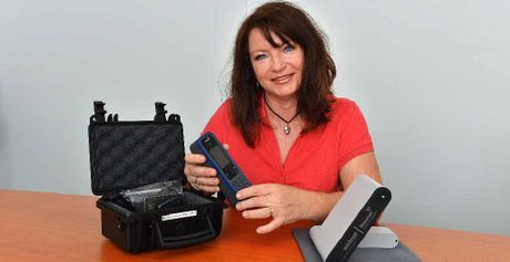 HELPING CYCLONE VICTIMS: Peta Williams helps organise satellite phones bound for the cyclone ravaged island nation of Vanuatu.