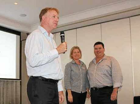 POSITIVE SIGNS: The Bank of Queensland's chief economist Peter Munckton, with Gladstone branch managers Rachel and Andrew Bauer, delivers an economic health check for the region.