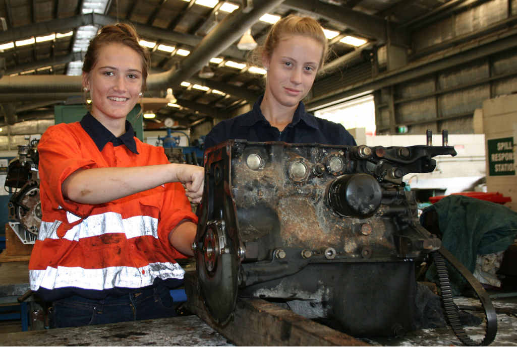 THINKING AHEAD: Tiarnee Malins and Sophie Smith are enjoying getting their hands dirty working on engines.