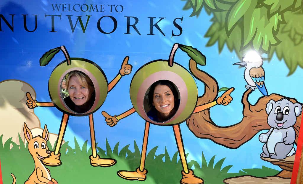 GO NUTS: Happy Nutworks staff members Karen Pitcher and Tamara Donovan love their job.