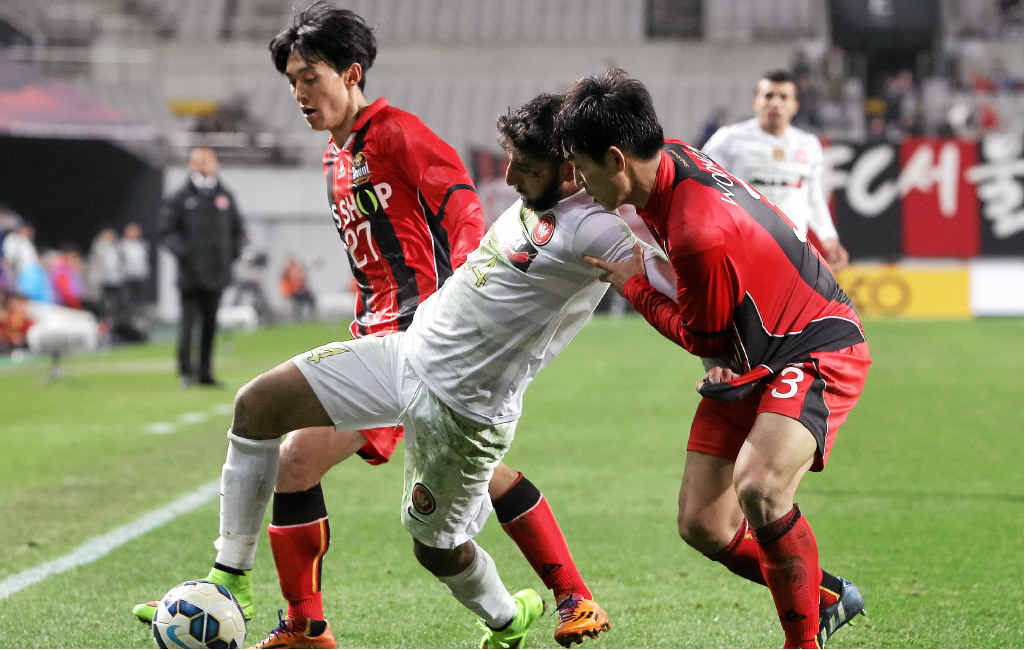 UNDER THE PUMP: Kerem Bulut of Western Sydney Wanderers competes for the ball in the team's eight game in 25 days against FC Seoul on Wednesday night.