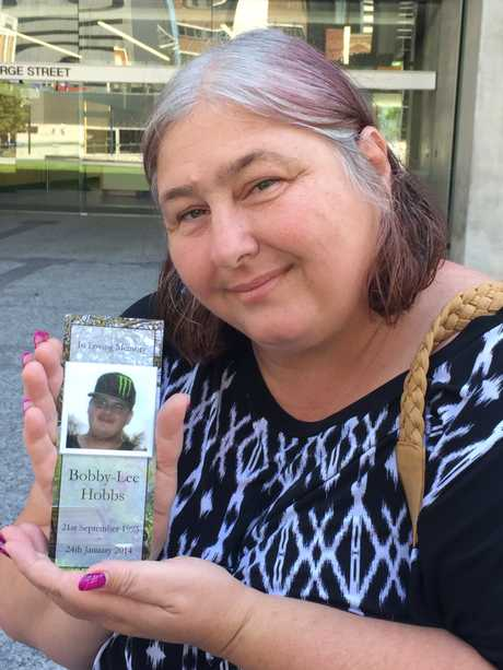 Mackay mother Tina Clarke hold a picture of her son Bobby Lee Hobbs, 20.