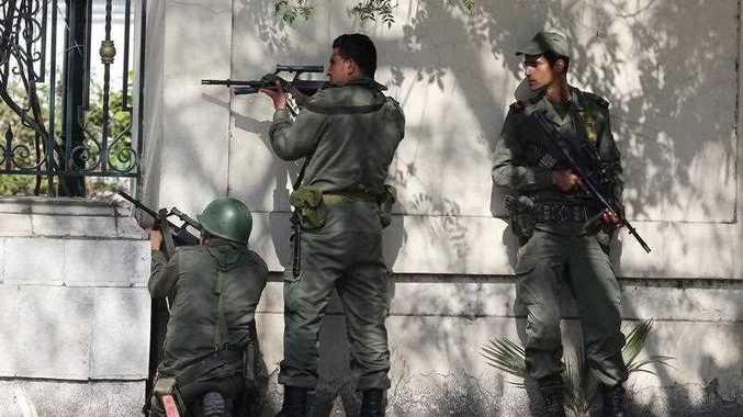 Members of the Tunisian armed forces take up positions during an operation against gunmen who opened fire on tourists at the National Bardo Museum, Tunis, Tunisia, 18 March 2015.