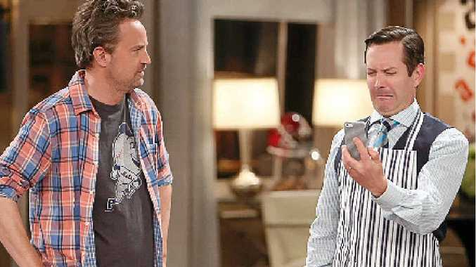Matthew Perry and Thomas Lennon in a scene from the TV series The Odd Couple.