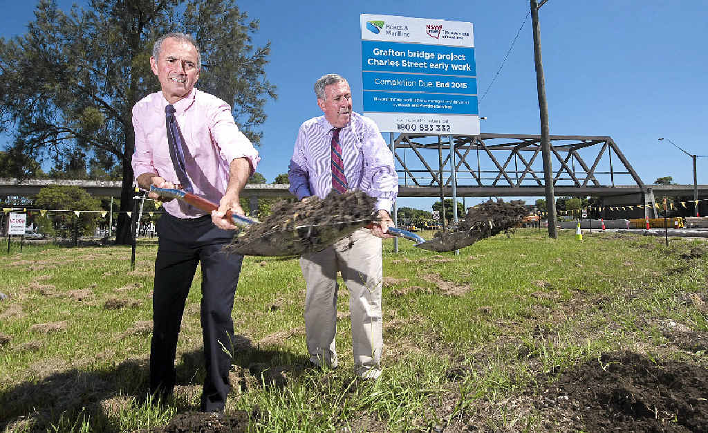 Member for Clarence Chris Gulaptis with minister for roads Duncan Gay turn the first sod on the work for the second Grafton bridge. Photo Adam Hourigan / The Daily Examiner