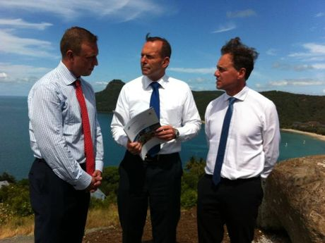 L-R State Minister for Environment Dr Steven Miles, Prime Minister Tony Abbott, and Federal Minister for Environment Greg Hunt.