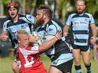 CRUNCH TIME: The Maroochydore Swans go on the attack against the Nambour Toads in the SGQ Cup rugby season opener.